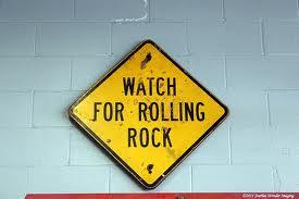 rolling rocks sign